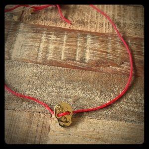 NWT Red String Skull Bracelet